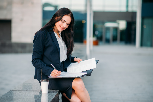 businesswoman in suit works with notebook