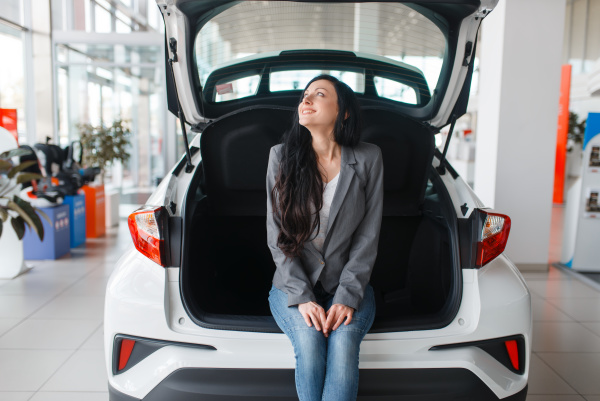 woman buying new car lady