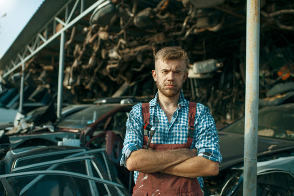 male mechanic at the stack of