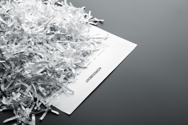 heap of white shredded papers