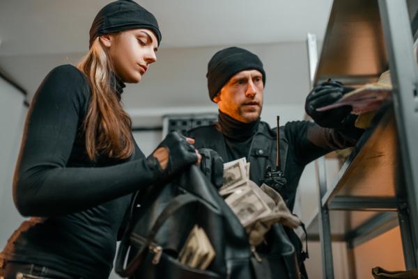 robbers in black uniform steals money
