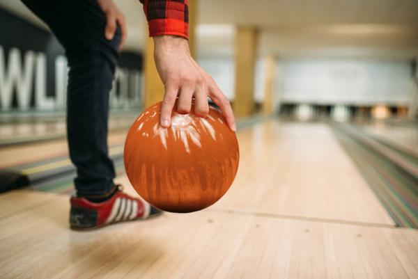 bowler makes throw closeup view