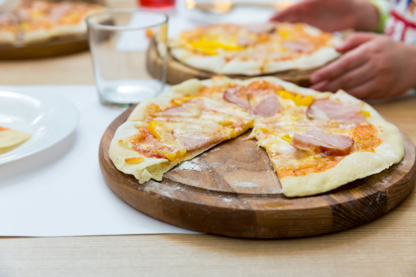 fresh pizza on a wooden stand