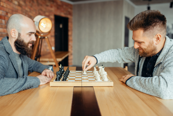 male chess players begin playing