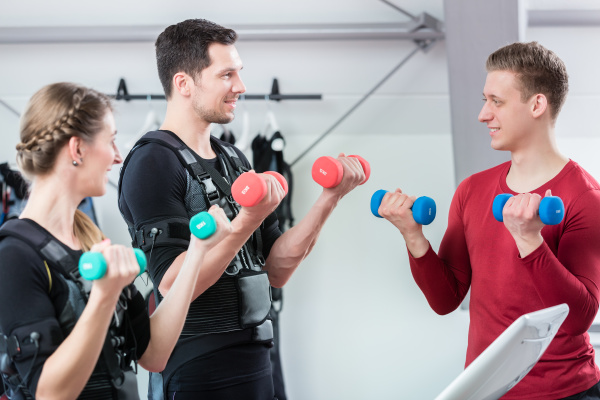personal trainer working with couple in