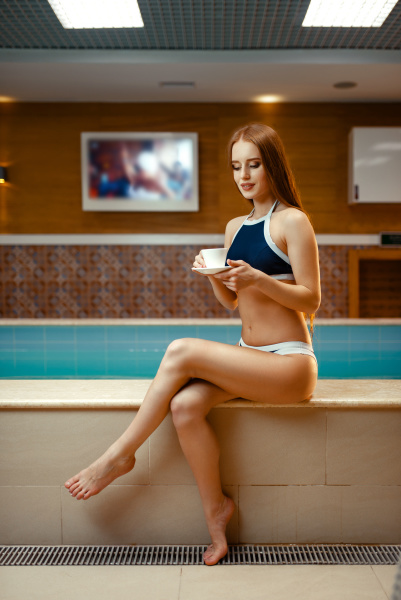 attractive woman drinks tea at the