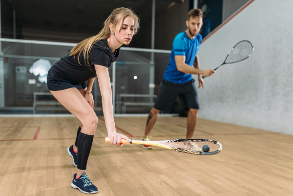 couple, with, squash, rackets, , indoor, training - 28076344