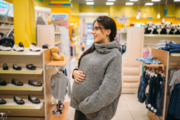 future mother in the store shoe
