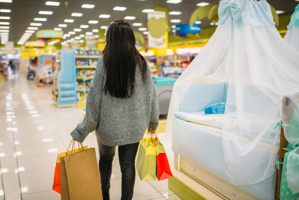 female person buying goods in store