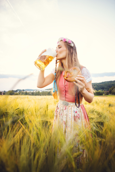 woman, in, traditional, clothing, drinking, beer - 28077134