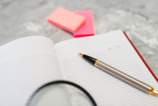 notebook and pen on the table