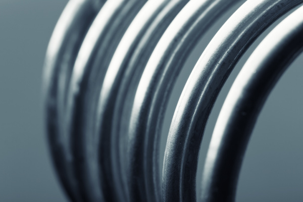 aluminum spiral isolated on gray background
