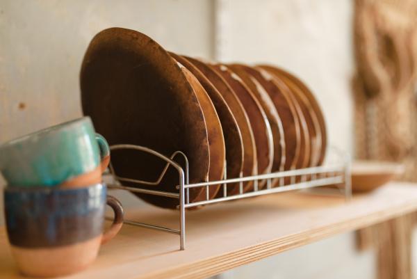 clay kitchen utensils on shelf in