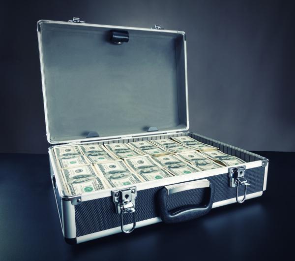 case full of money on gray