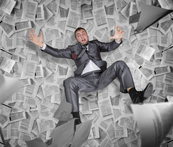 businessman among the pile of papers