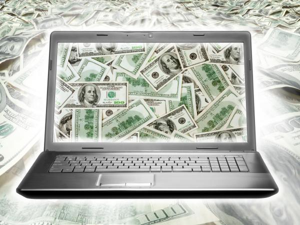 laptop full of dollars