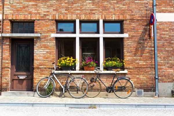 bicycles at ancient building facade