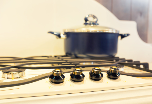 stove with saucepan on the white