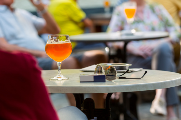 tourists drinks beer in street cafe