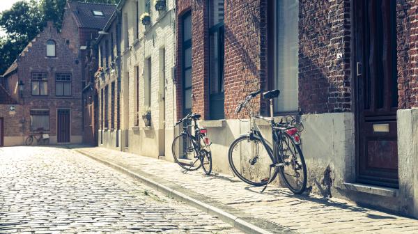bicycles at old building facade cozy