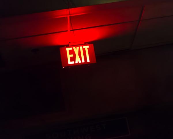 illuminated red exit sign