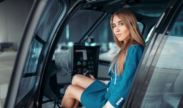 female pilot in helicopter view from
