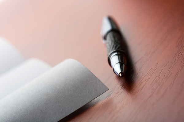 letter and pen on the desktop
