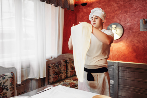 chef in apron and hat making