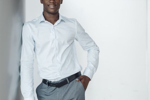 black businessman poses in office building