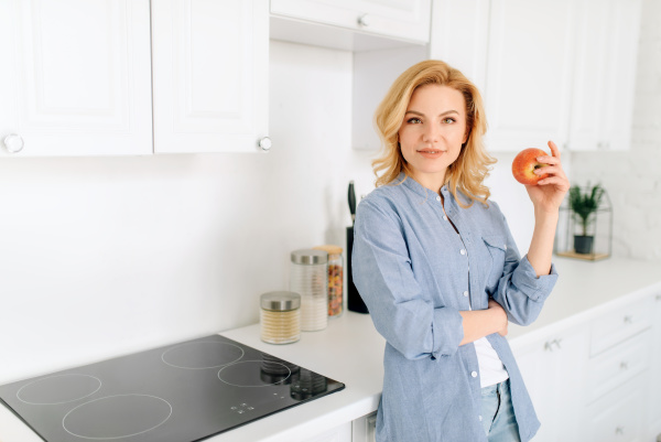 woman poses on kitchen with snow