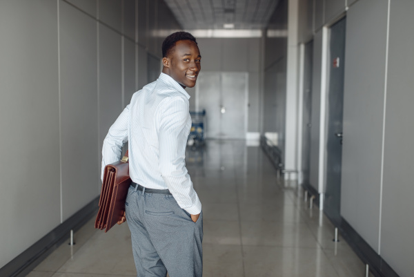 black businessman with briefcase in office