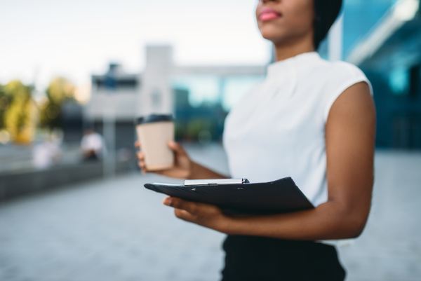 female business person with coffee cup