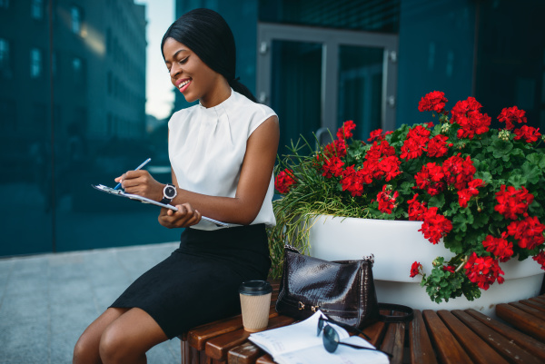 business woman with notepad sitting on
