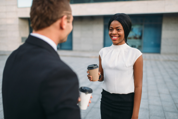 business woman and businessman with coffee