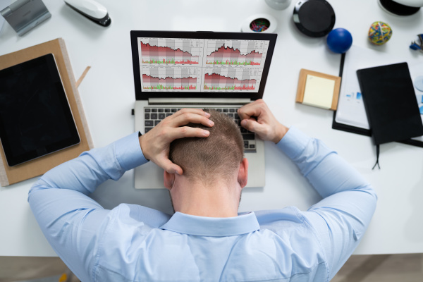 stressed businessman in front of laptop