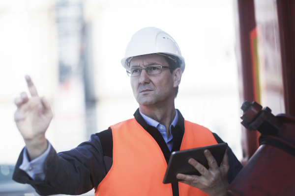 engineer using digital tablet at port