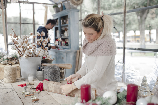 woman creating christmas ornaments in shop
