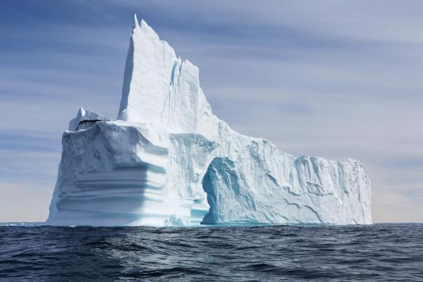 majestic iceberg formation on sunny blue