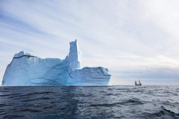 majestic iceberg formation over sunny blue