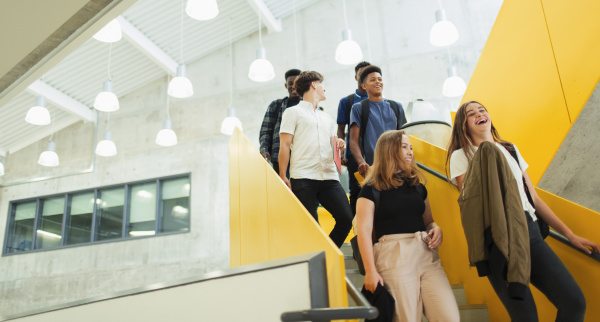 junior high students descending stairs