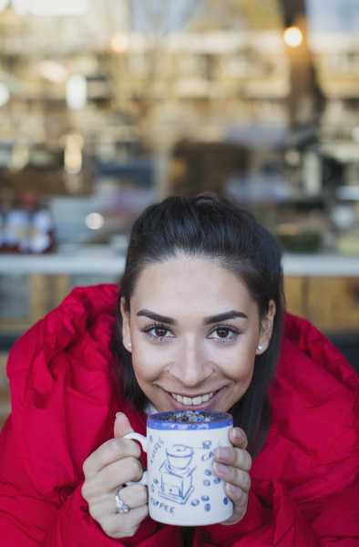 portrait smiling confident young woman drinking