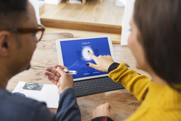 couple, paying, bills, online, , using, fingerprint - 28127876