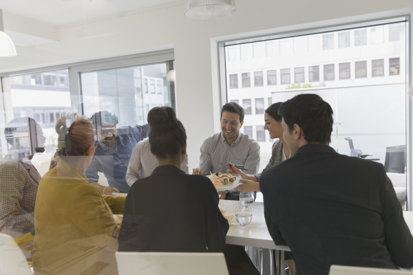 business people eating sushi lunch in