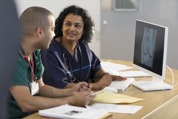 doctors looking at digital x ray