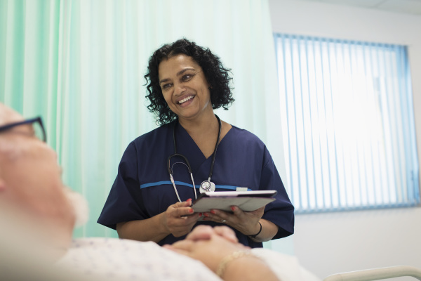 nurse with digital tablet making rounds