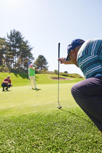 male golfer preparing to take shot