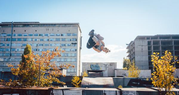 acrobat man doing somersault mid air