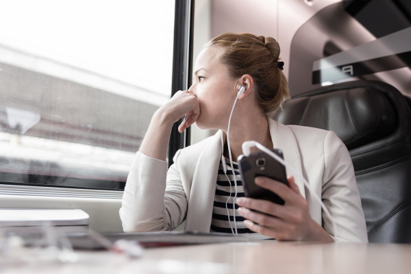 businesswoman communicating on mobile phone while