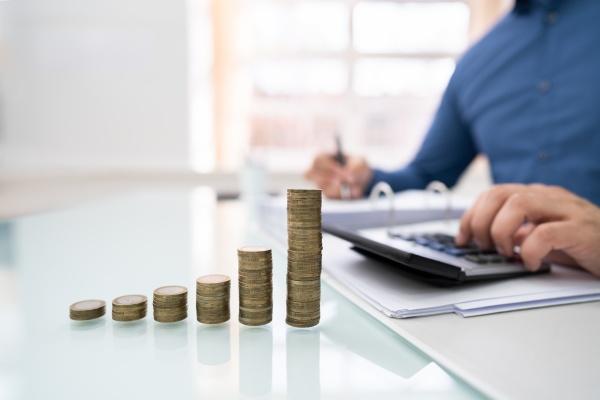 man calculating financial work