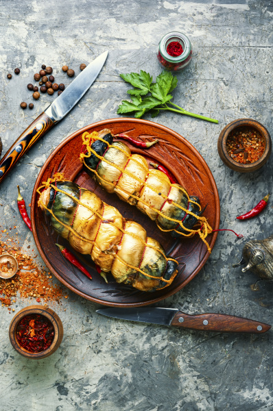 smoked mackerel on wooden table